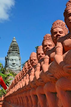These statues in Krong Battambang, Cambodia are crazy cool. I love their orange color, and of course the giant statue seen in the back of the picture!