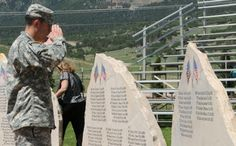 Sgt. Brian Gutierrez, infantryman, Company D, 1st Battalion, 67th Armor Regiment, 2nd Brigade Combat Team, 4th Infantry Division, salutes his fallen comrades during a warrior memorial ceremony at the Mountain Post Global War on Terrorism Fallen Soldiers' Memorial. Families, friends, and soldiers of Fort Carson remembered nine soldiers who had lost their lives serving in Afghanistan in support of Operation Enduring Freedom.(U.S. Army photo by Staff Sgt. Andrew Porch, 2nd BCT PAO, 4th Inf…