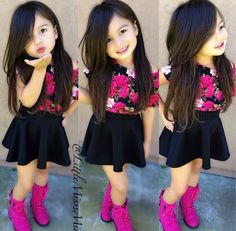 What a cute girl! I love her outfit!