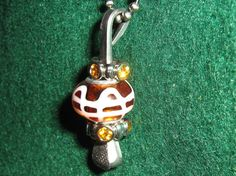 Lucky Horseshoe Nail Pendant with Amber and by BulletsAntlersEtc, $15.00