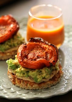 hummus and avocado toast topped with roasted tomato :: layer, hummus & avocado, sprinkle with salt and pepper then top with tomato