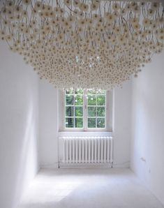 art installation of 2,000 suspended dandelions by Regine Ramseier.