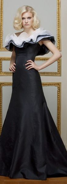 Dilek Hanif ~ Love the dress. The model looks like she's gonna hurt someone.