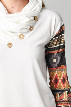 Neck too high, no to Aztec patterns, and white stains too easily.