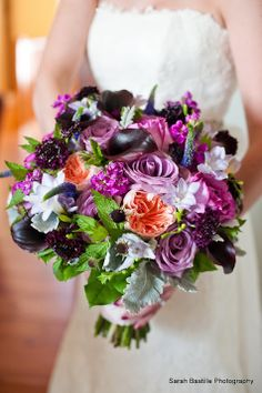 http://dandieandiefloraldesigns.com/wp-content/uploads/2014/01/PurpleBouquets-125.jpg - radiant orchid and dazzling blue color palette. This bouquet has just a touch of blue, I would use a few Sea Holly flowers.