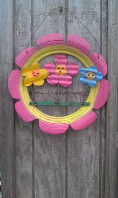 Recycled Tire Flower Group Made in the USA by JunkFx, available at Barn Owl Gift & Greenhouse on Facebook (colors may vary)