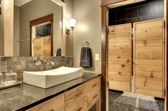 Beautiful Swinging Door for Your Home Room Style : Bathroom With Beige Wall And Faucet Also Granite Plus Raised Sink And Saloon Swinging Doors And Sconce Plus Stone Tile Backsplash Also Mirror And Stone Tile Shower Floor For Transitional Bathroom Design