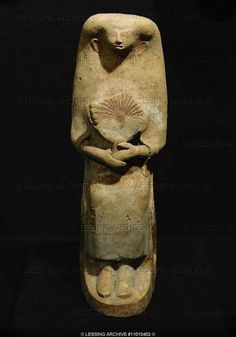 Phoenician sculpture, mother goddess with fan, yellowish terracotta from the Punic Necropolis of Dermech, Carthago Musee du Bardo,Tunis-Tunicia