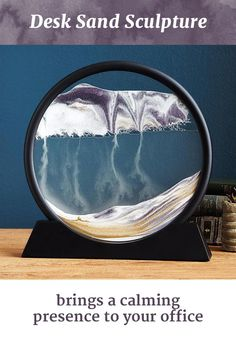 Simply rotate the glass ring and watch as delicate drifts of light and dark sand shift into deserts, mountains, clouds, rain, oceans and smoke, all ebbing and flowing into one another. Your desk will never be the same