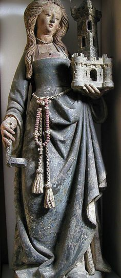 Saint Barbara, patron saint of prisoners, architects, and artillerymen. Limestone, paint, gilt ca. 1500, Northern France