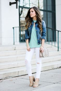 Easy and attainable spring outfit! Featuring a simple denim jacket, cut out front blouse, and distressed white jeans. This look will take you through the day and into the evening!