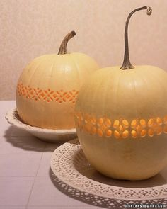 Delicate openwork, inspired by eighteenth-century English pierced creamware, turns these pale 'Lumina' pumpkins into ornate decorations.