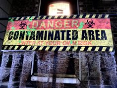 Danger! Contaminated Area sign found at Party City for the final touches on the zombie party front lawn.