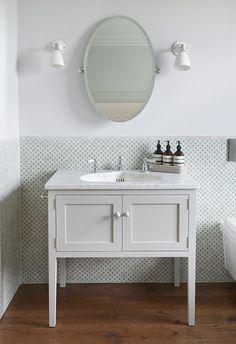 Victorian House, North London. Habibi tiles and classic English cabinetry combine to make a unique bathroom scheme #interior #design #grey #green #white #mirror #basin #china
