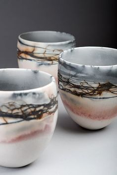 June Ridgway  |  Smoke-fired vessel (2012). Coiling handbuilding technique. Pieces are placed in saggars with copper, salt and sawdust creating unique marks and colour.