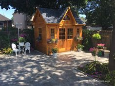 This quaint x Copper Creek in Toronto, ON features elegant double doors, a fan arch window and antique flower boxes! Garden Care, Small Wood Shed, Garden Shed Kits, Studio Shed, Backyard Retreat, Arched Windows, Shed Plans, Garden Spaces, Building Plans
