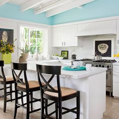A touch of light blue paint adds cheer to this cute kitchen. See more ideas for small kitchens: http://www.bhg.com/kitchen/small/custom-touches-for-small-kitchens/?socsrc=bhgpin022313oceanblue=18