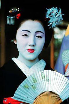 Tamakasu, okasan of Tama Okiya, as a maiko wearing dragonfly kanzashi
