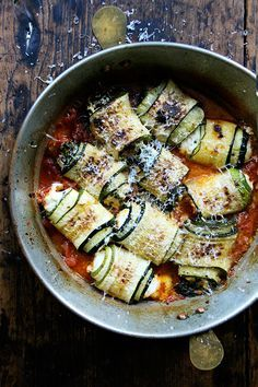 In this zucchini involtini, the ricotta filling is mixed with sautéed chard and lemon zest, but I've had success using leftover fresh corn polenta, chopped up roasted red peppers, and cubes of mozzarella, which makes me think the possibilities for involtini are endless.
