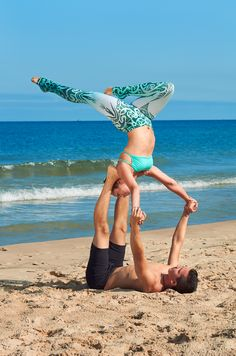 Flying high with some beach acro yoga. Leggings from the Uniquely Yoga boutique.