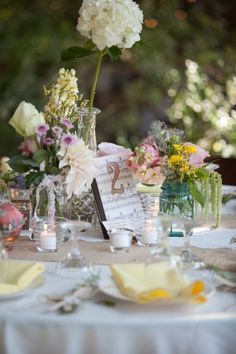 I love the wild flower look, a mixture to fill the table in small sweet vases. <3