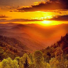 Sunset in the Smoky Mountains.  MY favorite hike- Mt Lecont in the fall. It can rain at the base, have fog  part way up, then snow on top when you finally ascend to the summit and find the sun.