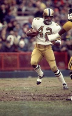 John Rally Gilliam born August 7, 1945 is a former WR for the New Orleans Saints. He played for the Saints from 1967-1968 and again in 1977. He is famous for returning the opening kickoff 94 yards in the Saints' inaugural game in 1967 against the Los Angeles Rams for their first touchdown in franchise history.