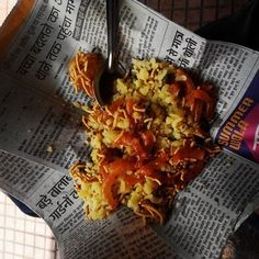 Poha (Indore): Soft and fluffy flattened rice that's traditionally served for breakfast, often with cut-up jalebis.