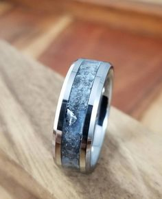 This tungsten meteorite band that's made with pigmented glow powder so it literally lights up — just like you when you see your partner come home.* 32 Stunning Engagement Rings You Can Get On Etsy Blue Wedding Rings, Blue Rings, White Gold Rings, Wedding Bands, Bohemian Wedding Rings, Wedding Suits, Original Engagement Rings, Iron Meteorite, Costume Jewelry Rings
