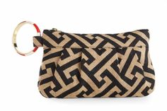 Printed jute clutch has jigsaw print and removable striped bangle for hands free hold.  Ten team color combinations.  Poly lined with interior pocket.