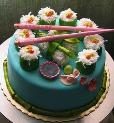 The cake is made out of spiced carrot ginger cake with cream cheese icing. All those cute little details, the chopsticks, soy sauce bowl, snap peas… they aren't plastic. Those are edible, made out of gum-paste, and the bamboo, wasabi, ginger… made out of fondant. The rice is coconut.