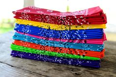 Bandanas as dinner napkins...inexpensive and snazzy way to color up the table!