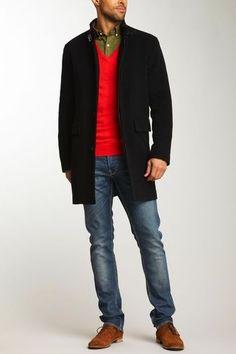 Men's Olive Longsleeve Shirt, Red V-neck Sweater, Black Overcoat, Blue Jeans, and Brown Suede Desert Boots