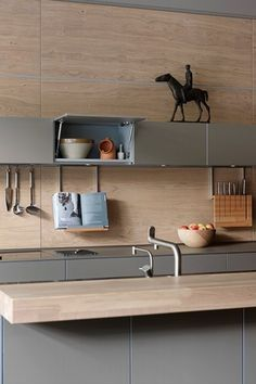 A Kitchen Design with grey Bulthaup units sawn oak wooden panelling and wine fridge. Kitchen design ideas for units, tiles, taps, modern city Kitchens Kitchen Interior, New Kitchen, Kitchen Decor, Kitchen Ideas, Kitchen Cupboard, Room Kitchen, Dining Room, Bulthaup Kitchen, Kitchen Worktops
