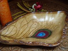 Hey, I found this really awesome Etsy listing at http://www.etsy.com/listing/79859701/wood-burned-peacock-feather-bowl