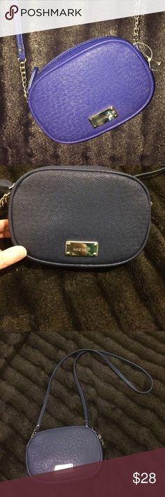 Nine West Royal Blue Crossbody Purse NWOT Small crossbody bag, 7 inches across 5 inches in depth. Strap length 23 inches. True color seen in last photo. Inner slots of ID and credit card. Nine West Bags Crossbody Bags