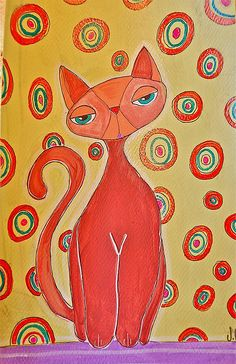 kitty in orange with circles