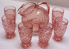 "Pink ""Waterford Waffle"" Depression Glass pitcher and tumblers."