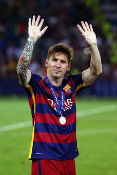 Lionel Messi Photos - Lionel Messi of Barcelona celebrates with his winners medal after victory in the UEFA Super Cup between Barcelona and Sevilla FC at Dinamo Arena on August 2015 in Tbilisi, Georgia. - Barcelona v Sevilla FC - UEFA Super Cup Leonel Messi, Barcelona Fc, Barcelona Players, Good Soccer Players, Best Football Players, Neymar, Messi Messi, Messi Soccer, Fotos Do Messi