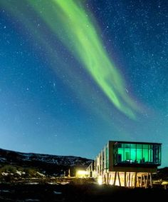 The Northern Lights Bar at the glass-walled ION Hotel. See other beautiful buildings in Iceland by clicking on the image. By TheCultureTrip.com