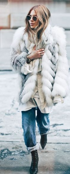 Fabulous faux fur coat paired with cuffed jeans, and round sunnies.