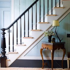 Steve Gambrel's Sag Harbor home in the Hamptons. Beautiful colour combination. We love that staircase and those duck egg blue timber clad walls
