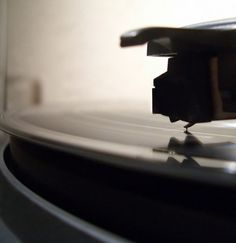 I love the crispness of the record pin and the reflection that is created by the shininess of the record