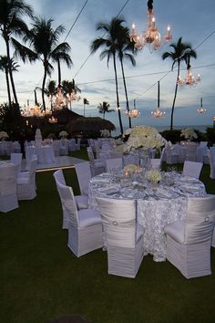 A white wedding dinner under the sunset and stars at @Four Seasons Resort Maui. Photography by Karl Bradford.
