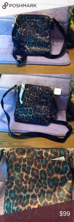 NWT Coach Ocelot Animal Print  Crossbody SwingPack Coach Ocelot Print Swingpack Style F50137        Sateen Fabric with Patent Leather Trim.  Inside and Outside Slip Pockets Zip Top Closure, Fabric Lining Adjustable Strap for Shoulder Crossbody Wear.  Approx:7.5 (L) x 8.5 (H). Color Gold hardware/ teal green multicolor Coach Bags Crossbody Bags