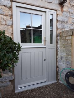 Stable door & frame manufactured in timber. Factory sprayed with a Teknos Farrow & Ball Hardwick White finish. Hung with a Winkhaus multi-point lock and pair of Croft handles Cottage Front Doors, Front Door Porch, Cottage Porch, Front Doors With Windows, Back Doors, Oak Front Door, Side Door, House With Porch, House Front