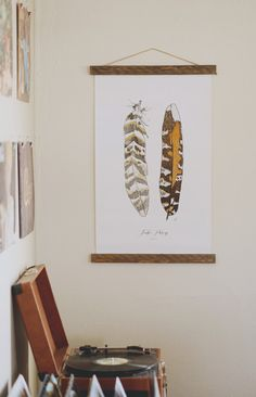 This canvas feather print would fit in well in all different types of homes.