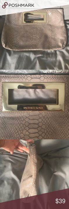 Michael Kors Blush Snakeskin Suede Clutch Well loved Michael Kors Clutch blush nude color soft suede not hard suede well loved tried to get all corners in pics they can be cleaned but I haven't tried as I'm afraid I would ruin it. Some scratches on gold hardware that's pretty normal. Please like, share, follow and make an offer thank you!! 💕💕💕 Michael Kors Bags Clutches & Wristlets