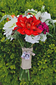 red and white wedding bouquet with photo charms to remember a lost loved one // thursday club wedding in san diego