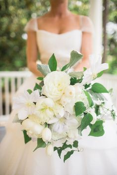 fluffy white bouquet, photo by Virgil Bunao http://ruffledblog.com/william-aiken-house-wedding #weddingbouquet #flowers #bouquets